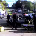 Paramedics remove SPD police officer from wrecked car